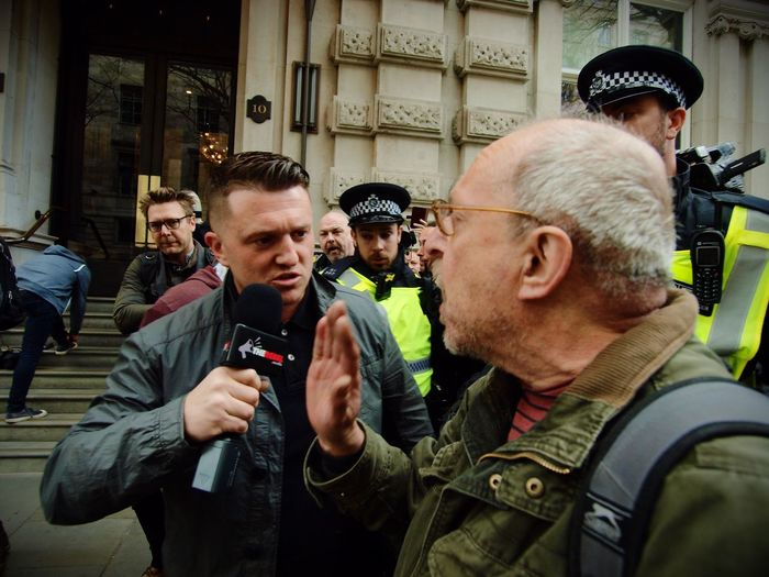 Tommy Robinson. Founder of the English Defence League, goading anti Facism protesters and being escorted away by Metropolitan police officers. London. 01-04-2017 Stevesevilempire English Defence League Tommy Robinson London London News Steve Merrick Olympus Right Wing EDL Racism Racist Zuiko Uk