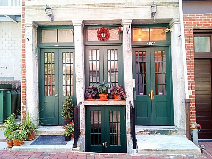 Architecture Building Exterior Built Structure Window Door Potted Plant Day Entrance Historic Façade Front Door Man Made Object No People Architectural Feature Outdoors City Façade Architecture Architectural Column Glass - Material Small Business City Life Storefront