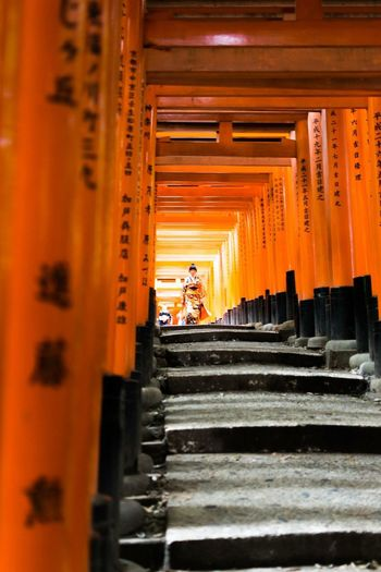 Kyoto - Japan Outdoors Art Orange Color Nikonphotography Kyoto Temple The Traveler - 2018 EyeEm Awards EyeEmNewHere Traveling Travel Photography Nikon Japan Cultures Tradition Architecture Built Structure Belief Orange Color Place Of Worship Spirituality Religion Architectural Column Steps And Staircases Shrine Selective Focus Travel Destinations The Traveler - 2018 EyeEm Awards EyeEmNewHere