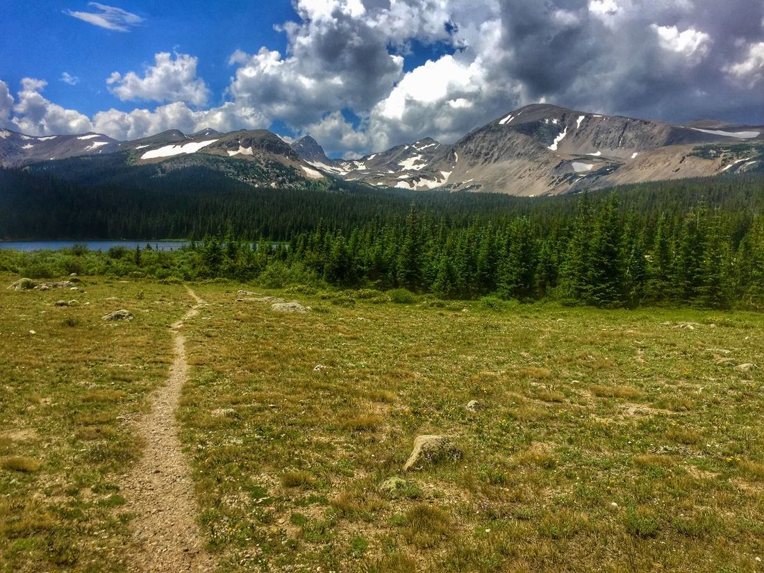Rocky Mountains, Colorado Mountain Beauty In Nature Nature Sky Outdoors Wilderness Landscape Cloud - Sky Scenics No People Scenery Grass Lake Water Snow EyeEm Selects Colorado Rocky Mountains Been There. Perspectives On Nature