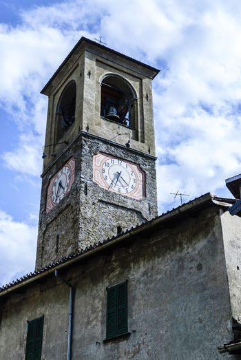 Clock tower in Carlazzo, Italy Architecture Astronomical Clock Bell Tower Building Exterior Built Structure Clock Clock Face Clock Tower Cloud - Sky Day Hour Hand Low Angle View Minute Hand No People Outdoors Place Of Worship Religion Roman Numeral Sky Spirituality Time