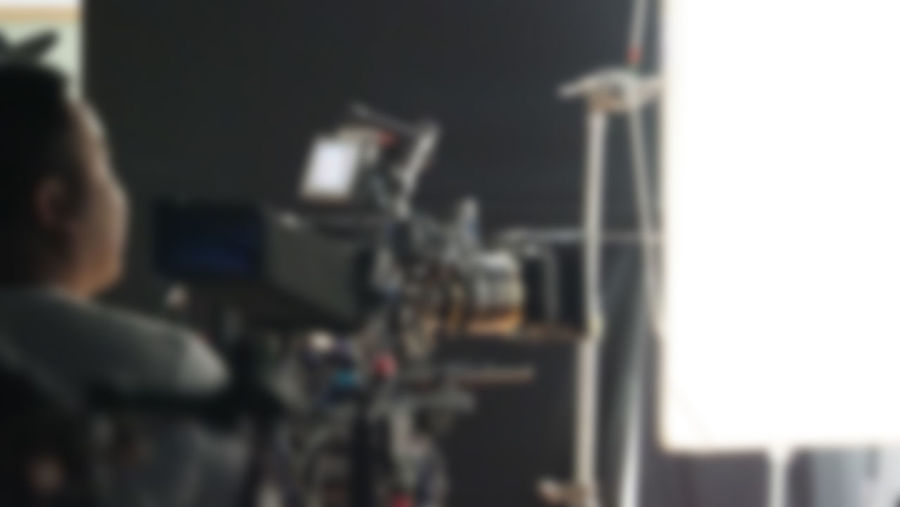 Blurry images of studio video shooting behind the scene or b-roll for online commercial and tvc which done by professional movie director film crew team and camera equipment with lighting set One Person Men Selective Focus Real People Transportation Rear View Occupation Focus On Foreground Indoors  Day Lifestyles Mode Of Transportation Portrait Land Vehicle Adult Headshot Sport Leisure Activity Video; Camera; Production; Film; Shoot; Studio; Movie; Professional; People; Equipment; Shooting; Background; Man; Tv; Digital; Work; Media; Behind; Interview; Industry; Operator; Maker; White; Television; News; Director; Cinema; Scene; Record; Broadcast;