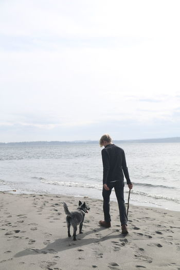 Woman with dog on beach