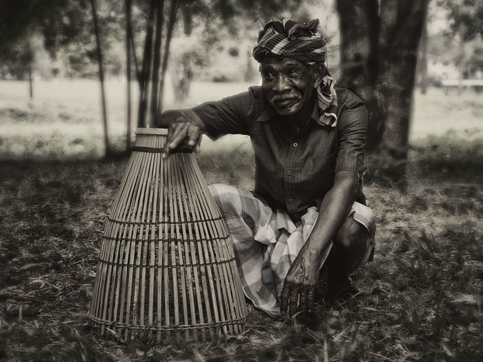 An old man with a bamboo fishing trap Bamboo Trap Black & White Monochrome Fisherman Old One Person Outdoors People Real People