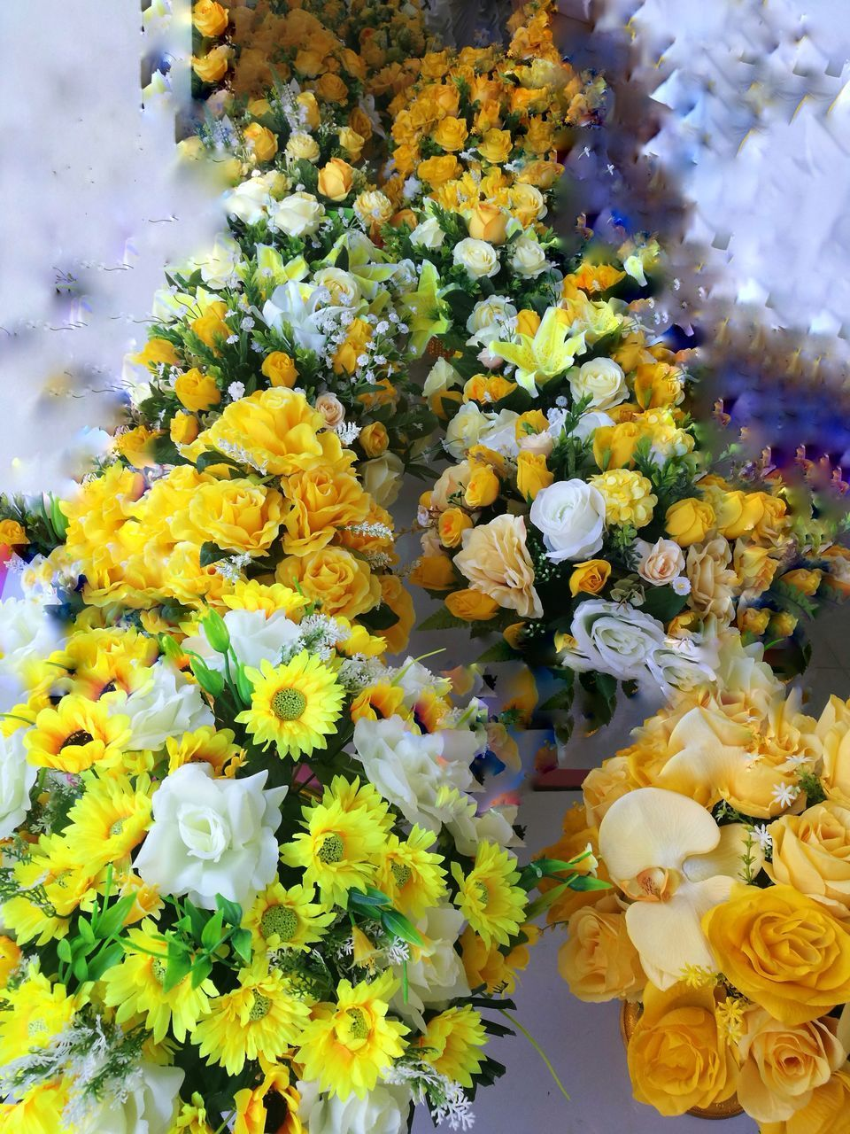 flowering plant, flower, vulnerability, fragility, plant, beauty in nature, freshness, yellow, flower head, inflorescence, nature, petal, close-up, multi colored, no people, flower arrangement, bouquet, day, outdoors, bunch of flowers, flower market, lantana