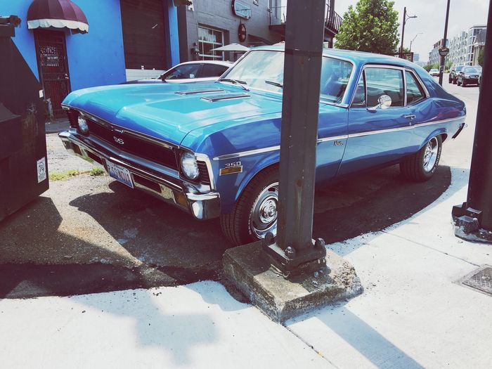 Car Land Vehicle Transportation Mode Of Transport Day Stationary Street Outdoors Architecture Built Structure Sunlight Shadow Building Exterior No People Blue Chevrolet Nova Ss