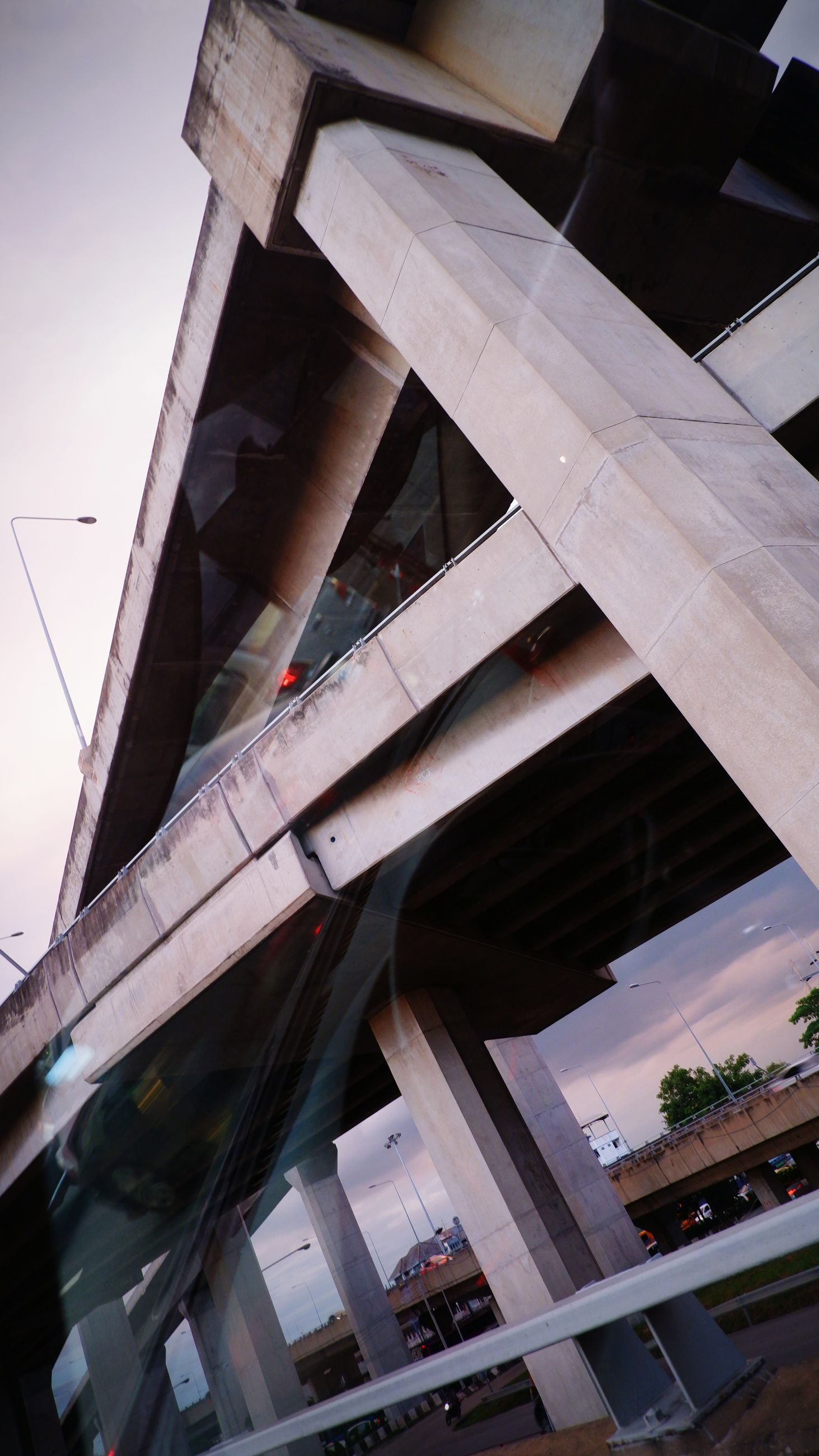 architecture, built structure, city, building exterior, urban area, transportation, bridge, no people, reflection, business finance and industry, low angle view, nature, sky, building, business, outdoors