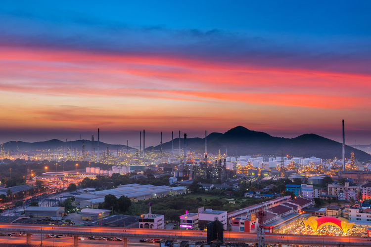 Oil and gas refinery plant Business Industry Plant Road Twilight Architecture Building Building Exterior Buildings Built Structure City Cityscape Cloud - Sky Dusk Factory High Angle View Illuminated Indsutry Manufacturing Mountain Oil Refinery Outdoors Sky Sunset TOWNSCAPE