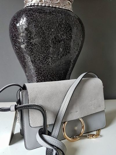 leather handbag Leather Leatherbag Millionaire Luxury Lifestyle Inspiration Luxurylifestyle  Business Close-up Fashion Industry Haute Couture Personal Accessory Fashion Designer Jewellery Womenswear Catwalk - Stage Gray Background Formal Portrait Textile Industry Fashion Show