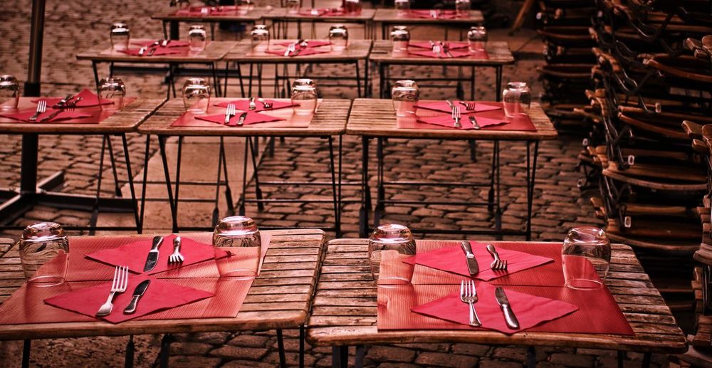 Close-Up Of Arranged Tables At Sidewalk