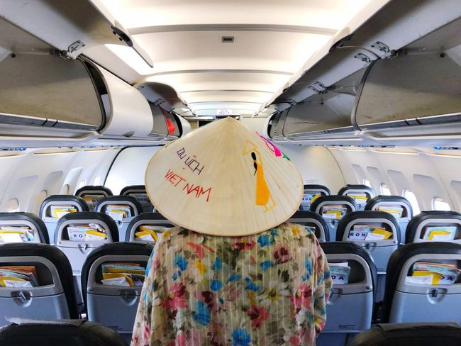 Transportation Mode Of Transportation Vehicle Interior Travel Vehicle Seat Air Vehicle Summer Exploratorium Rear View Real People Security Protection Indoors  Day Public Transportation Clothing Seat One Person Women Airplane Land Vehicle