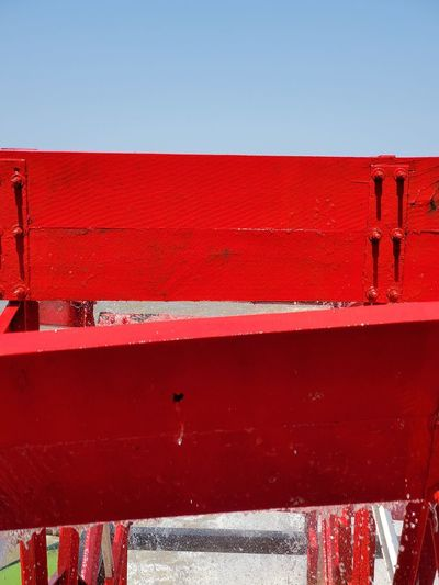 Close-up of red wall against clear sky
