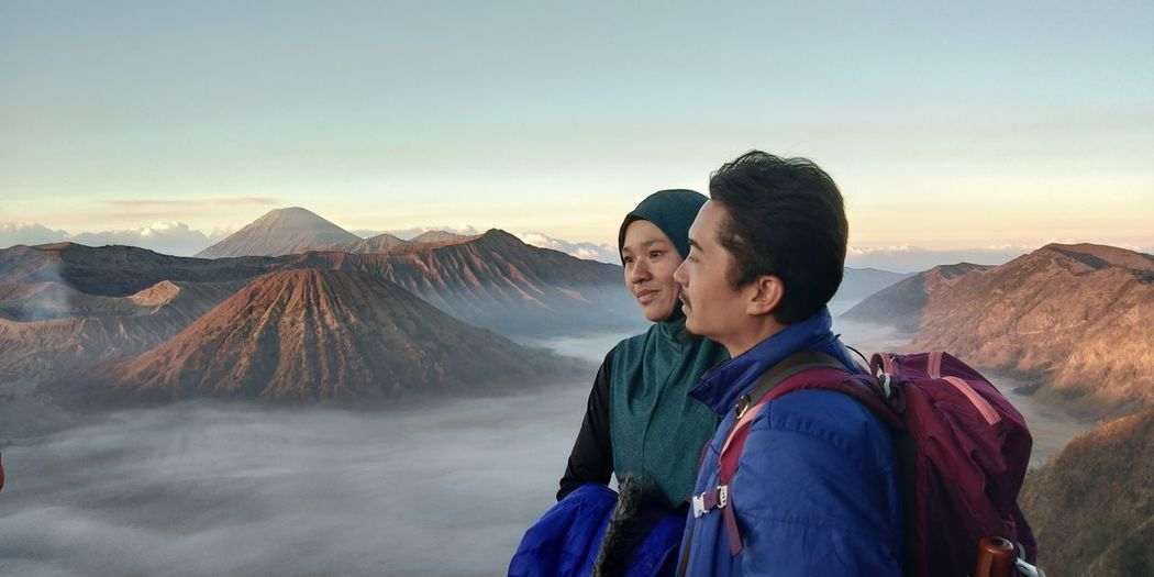 Couple Standing Against Mt Bromo