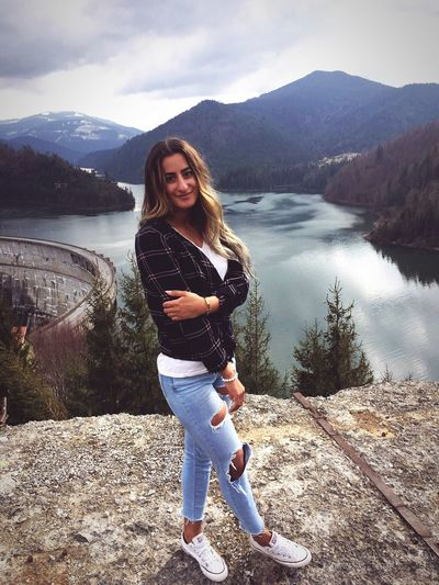 Water One Person Leisure Activity Full Length Lifestyles Young Adult Real People Sky Looking At Camera Casual Clothing Nature Sunlight Mountain Young Women Outdoors Lake Mountain Range Day