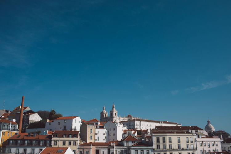 Townscape against blue sky
