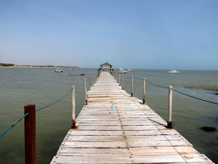 Senegal Water Sea Sky Pier Tranquility Nature Scenics - Nature Beauty In Nature Direction Clear Sky Horizon Over Water The Way Forward Tranquil Scene Horizon No People Beach Wood - Material Railing Land Outdoors