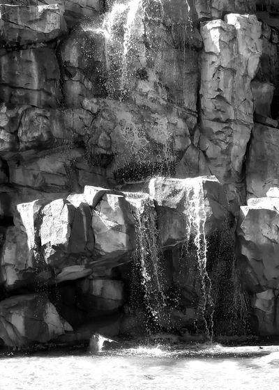 Full frame shot of rocks by wall
