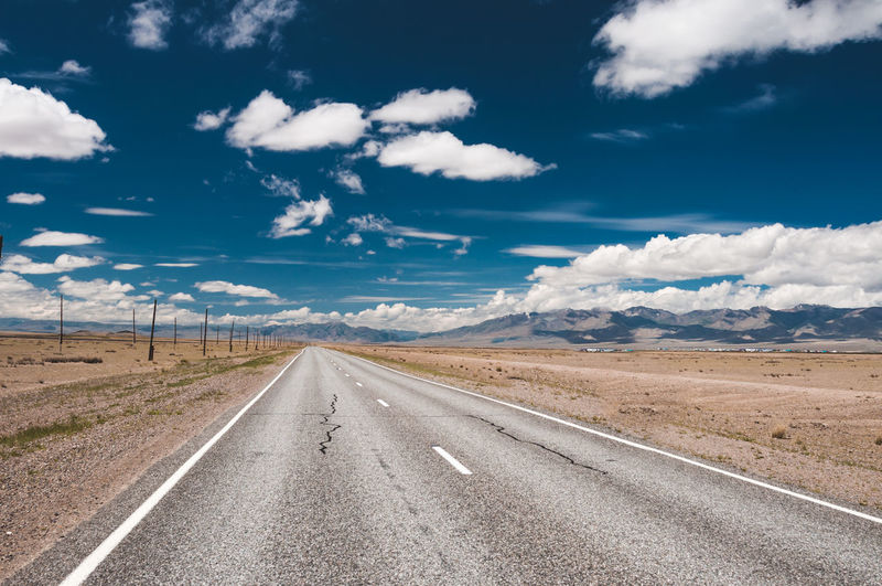 Beauty In Nature Cloud - Sky Day Diminishing Perspective Direction Dividing Line Empty Road Environment Land Landscape Long Nature No People Non-urban Scene Outdoors Road Scenics - Nature Sky The Way Forward Tranquil Scene Tranquility Transportation vanishing point EyeEmNewHere