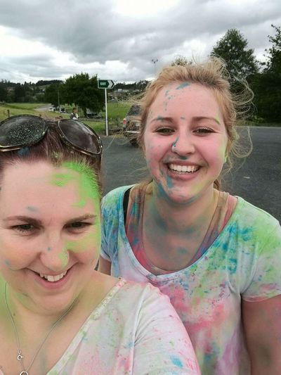 Enjoy The New Normal Rainbow Fun Run Two People Portrait Toothy Smile Smiling Happiness Looking At Camera Young Women Young Adult Adults Only Adult Sky People Women Cheerful Friendship Togetherness Day Only Women Outdoors Powder Paint