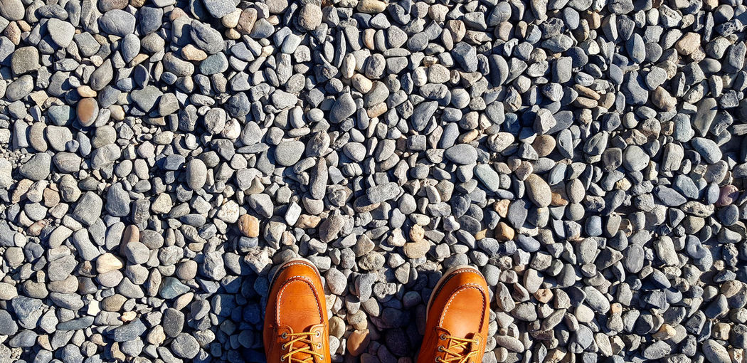 Low section of man standing on stones