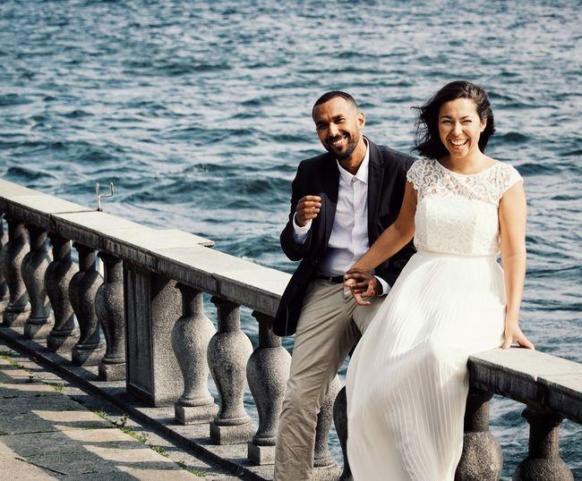 Smiling couple sitting on railing