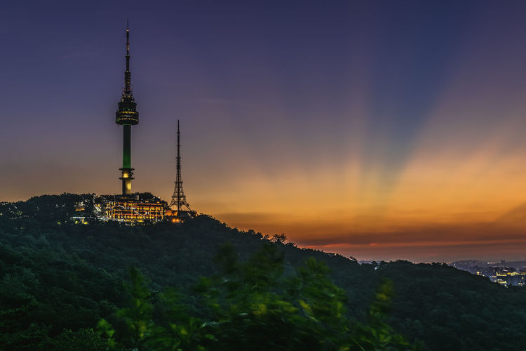 Twilight Seoul Tower in Spring at south korea. Architecture Belief Building Building Exterior Built Structure City Cityscape Global Communications Nature No People Orange Color Outdoors Place Of Worship Religion Sky Spire  Sunset Tall - High Tourism Tower Travel Travel Destinations