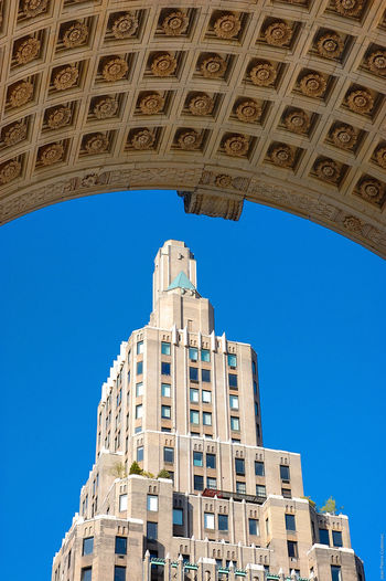 Low Angle View Of Building Against Clear Blue Sky At Washington Square Park