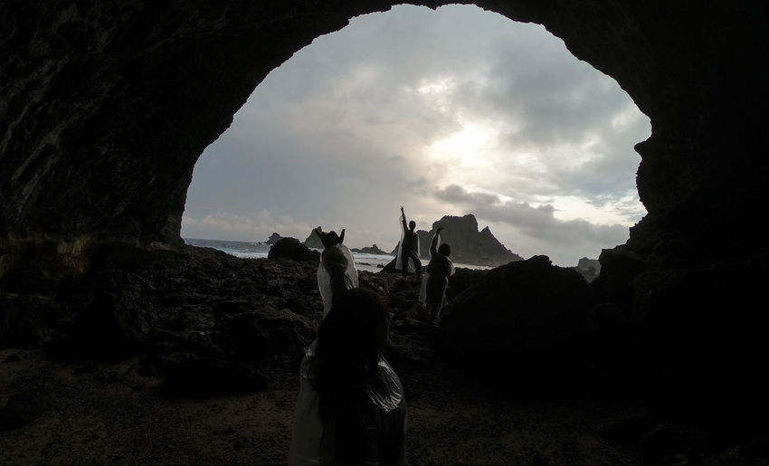 Taiwan Beauty In Nature Cave Cloud - Sky Day Greenisland Leisure Activity Lifestyles Men Natural Arch Nature One Person Outdoors People Real People Rock - Object Rock Formation Scenics Sky Standing Women