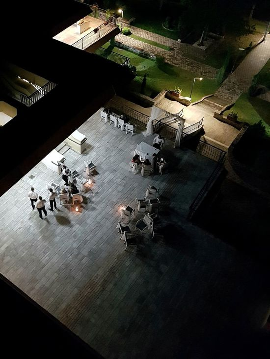 Wedding party at the hotel. Inside, people are dancing. The photo is unsharp, but I like what I saw. High Angle View Night Illuminated Outdoors Wedding Wedding Party Waiters  People Sitting Guests Wedding Guests