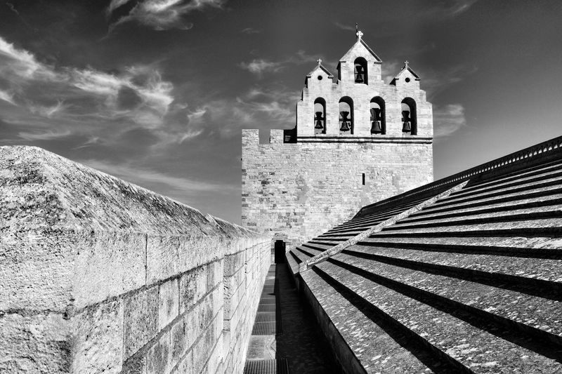 Saintes-Maries-de-la-Mer, France Blackandwhite Black And White Architecture_collection Black & White Architecture Rooftop View  Light And Shadow EyeEmNewHere Taking Photos EyeEm Best Shots My Point Of View Provence France Old Town Rooftop Architecture Built Structure Building Exterior Building Sky Cloud - Sky Nature Low Angle View Place Of Worship Spirituality Tower No People The Past History