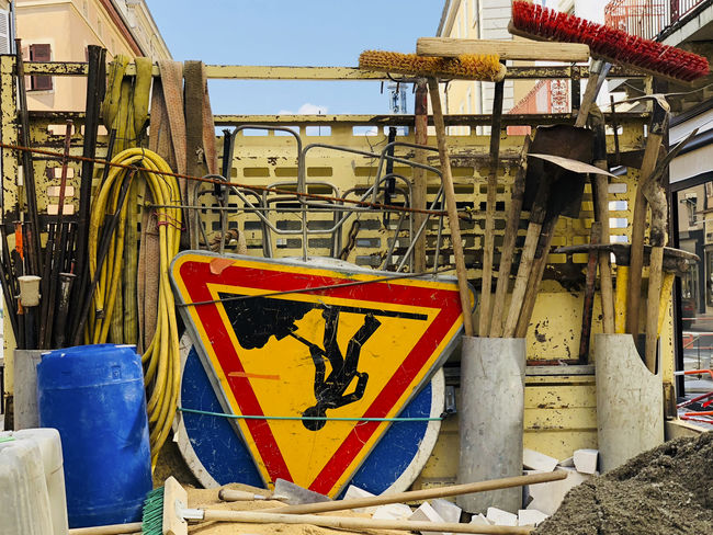 Architecture Blue Building Exterior Built Structure Clear Sky Communication Construction Industry Construction Site Day Industry Metal Nature No People Old Outdoors Sign Sky Sunlight Warning Sign Yellow