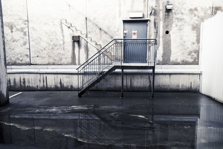 Staircase of building in a parking garage Concrete The Architect - 2019 EyeEm Awards The Street Photographer - 2019 EyeEm Awards My Best Photo House Absence Wall Residential District Reflection Outdoors Steps And Staircases Window Day Building Building Exterior Parking Garage City Modern Flooring Railing Corridor Door Built Structure Street Old Entrance Empty Wall - Building Feature Urban Scene Indoors  No People Architecture Steps Staircase