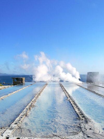 Thermal pool against blue sky