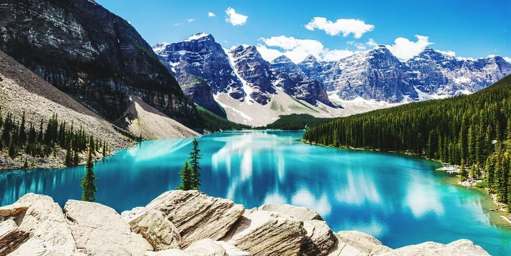 Marine lake Mountain Snow Mountain Peak Lake Mountain Range Pinaceae Turquoise Colored Scenics Wilderness Blue Reflection Pine Tree Landscape Travel Destinations Glacier Nature Hiking Water Forest Snowcapped Mountain