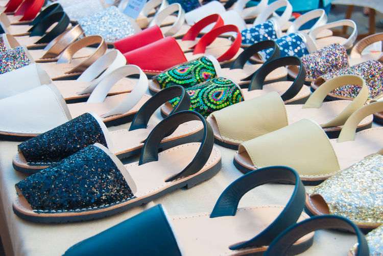 Spanish Shoes Abundance Arrangement Choice Close-up Day Fashion For Sale Glasses High Angle View In A Row Indoors  Large Group Of Objects Market Multi Colored Personal Accessory Retail  Retail Display Shoe Shoes Slipper  Still Life Table Variation Womenswear