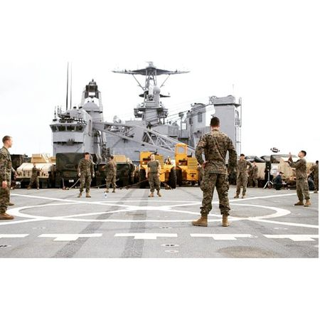 """Marines toss the football around on the flight deck of the USS Germantown during the """"Steel Beach"""" cookout. Marines USMC Military Navy teamcanon photooftheday ship igaddict"""