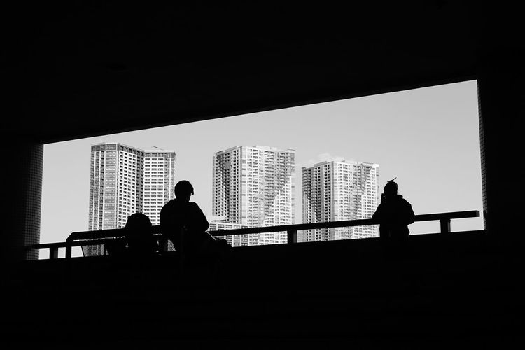 Architecture Building Exterior Built Structure City Copy Space Dark Day Group Of People Leisure Activity Lifestyles Men Nature Office Building Exterior Outdoors People Railing Real People Silhouette Sky Skyscraper Standing EyeEmNewHere