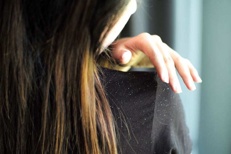 Close-up of woman with hand in hair