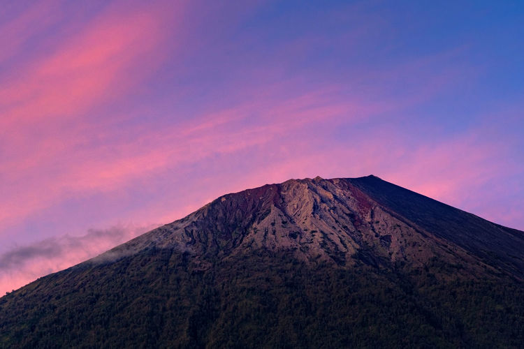 Low Angle View Of Mount Rinjani Against Sky During Sunrise