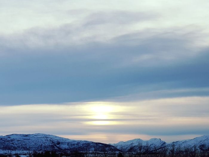 the sky looks like the ocean Blue Bestsellers Norway Bodø Clouds And Sky View Sun Winter WOW Atwork Heaven Sky Sunlight Sunset Snow Mountain Cold Temperature Winter Sunset Polar Climate Beauty Sky Landscape Cloud - Sky Tranquil Scene Calm Countryside Idyllic Non-urban Scene