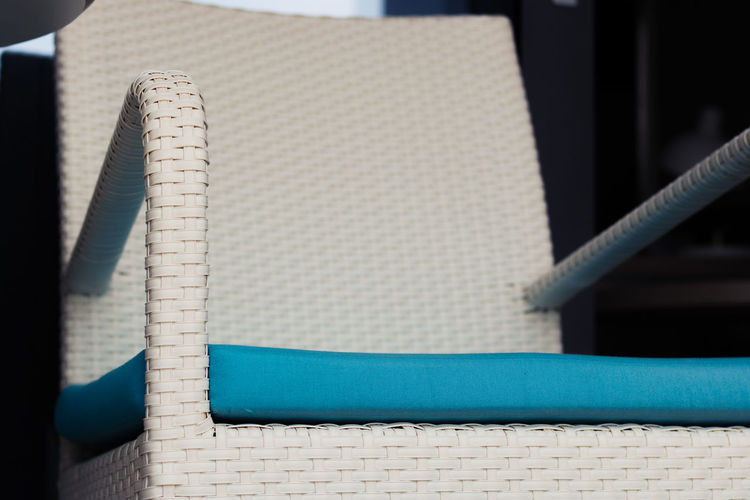 Close up of white chair on a terrace.