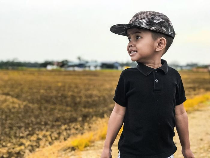 Daddy....i am in paddy field ..... One Boy Only Focus On Foreground Casual Clothing