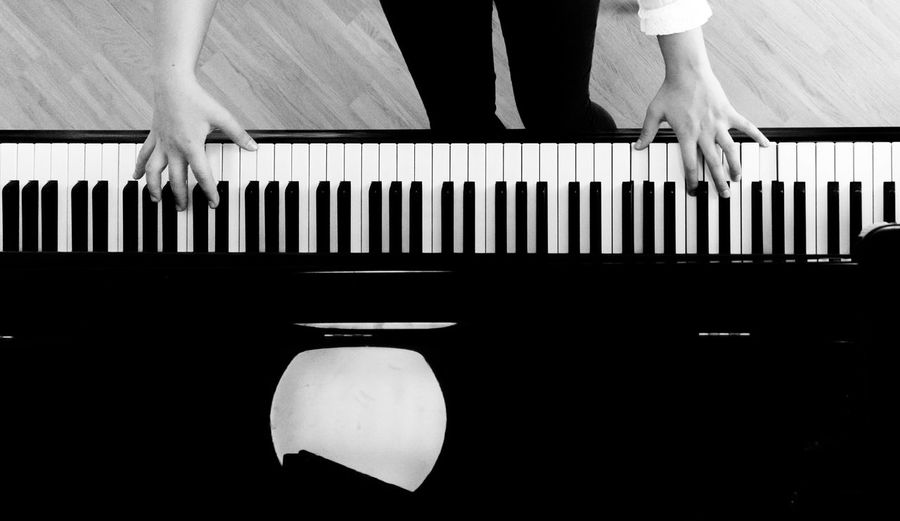 Directly Abovee Shot Of Woman Playing Piano