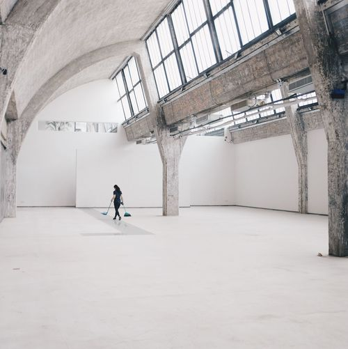 Man in corridor of building