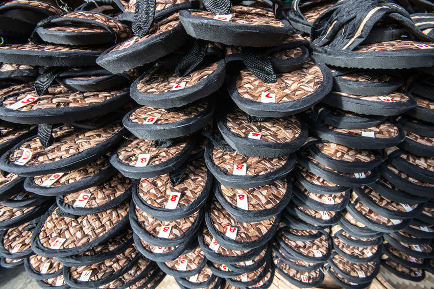 Tsinelas for sale Sandals Flip Flops Market For Sale Business Footwear Tsinelas Sandals Indigenous  Cultural Philippines Eyeem Philippines Footwears Rattan Full Frame Backgrounds Abundance Large Group Of Objects No People Day Outdoors