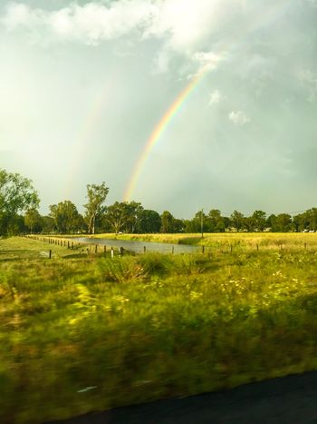 Over the rainbow Rainbow Nature Double Rainbow Beauty In Nature Tranquil Scene Scenics Tranquility Field Outdoors Water Landscape Tree