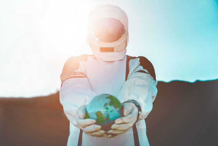 Spaceman holding earth planet - Astronaut travel in space - Saving the world, discovering new galaxy and future concept Astronaut Galaxy Man Planetary Moon Spaceman Day Globe Hearth Holding One Person Planet Save Sky Space