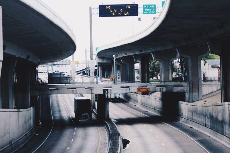 Semi-Truck Below Bridge On Highway