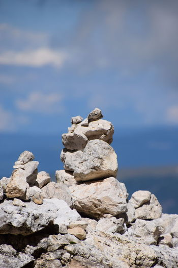 stack of stones in balance Stack Balance Beauty In Nature Close-up Cloud - Sky Day Nature No People Outdoors Rock - Object Scenics Sky Stable Stapled Tower Tranquil Scene Tranquility Unstable Water