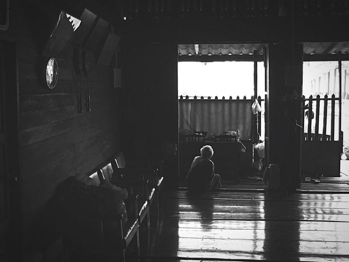 Snapshots Of Life Light And Shadow Photooftheday Blackandwhite Taking Photos People Photography An old lady sitting at the door alone, with nothing to do. She seems to cherish the old good time of her young age - a place in Amphawa, Samut Songkhram, Thailand. Amphawa, a truly local floating market for Thais. The Traveler - 2015 EyeEm Awards The Photojournalist - 2015 EyeEm Awards Thailand EyeEm Black & White Spotted In Thailand Blackandwhite Photography EyeEm Best Shots - Black + White EyeEm Best Edits Black And White EyeEm Gallery